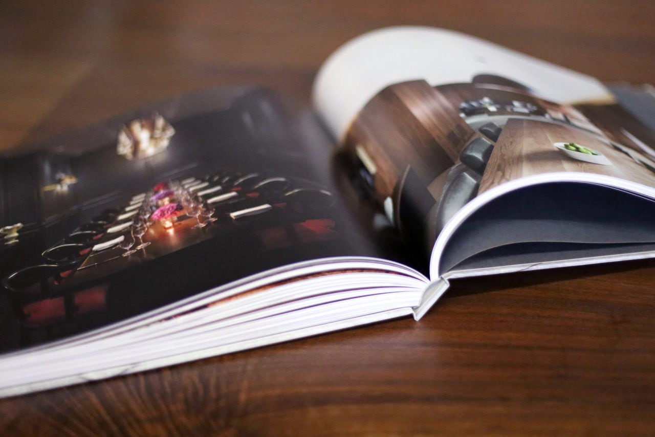 an open SENTIENT contemporary designed catalog luxury design book